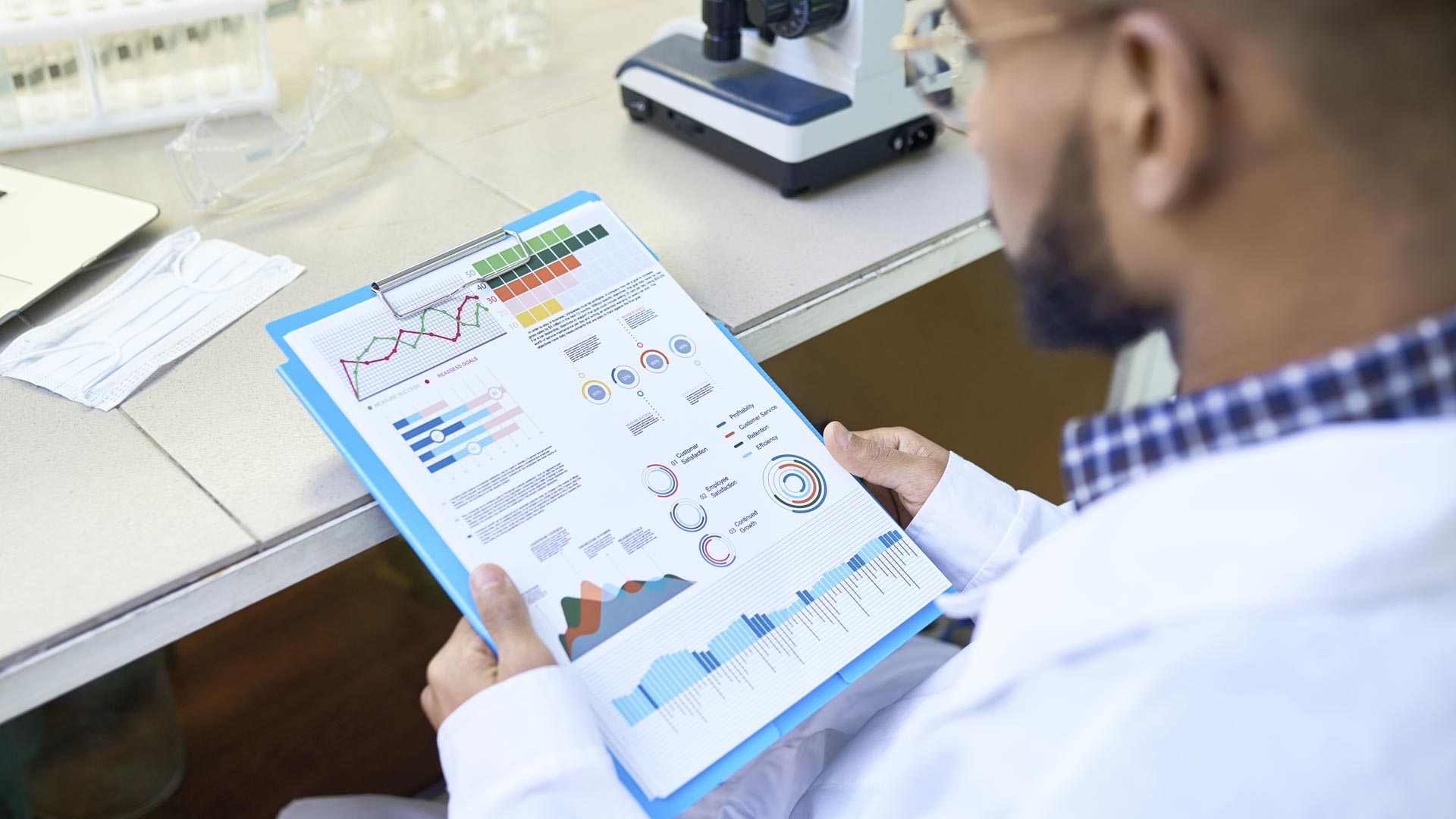 Scientist looking at medical data report