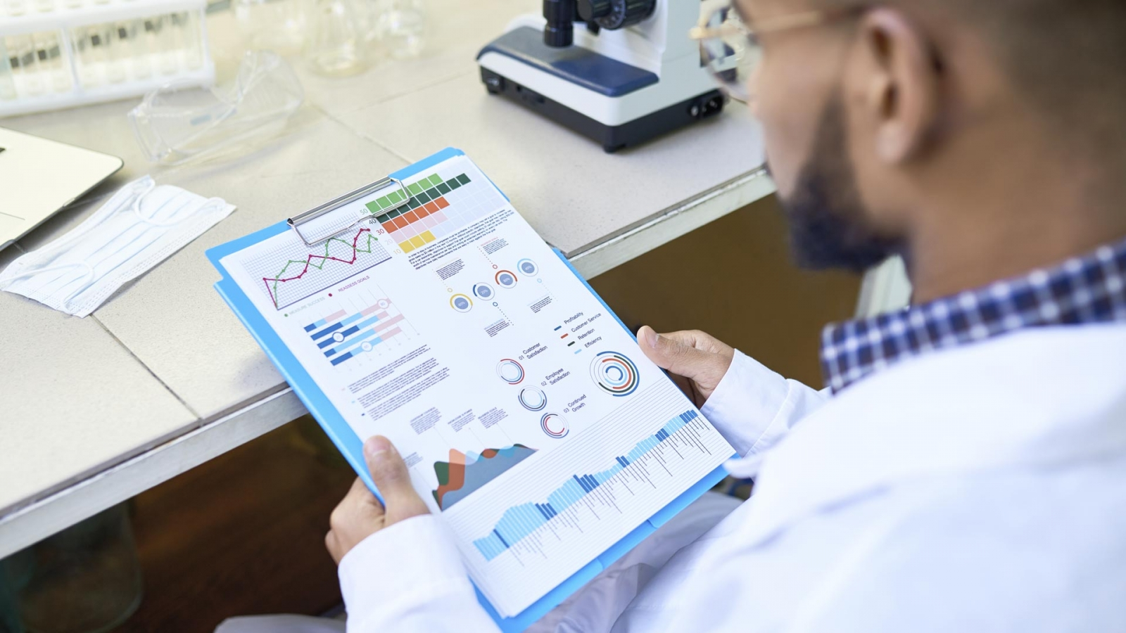 Scientist looking at a medical data report