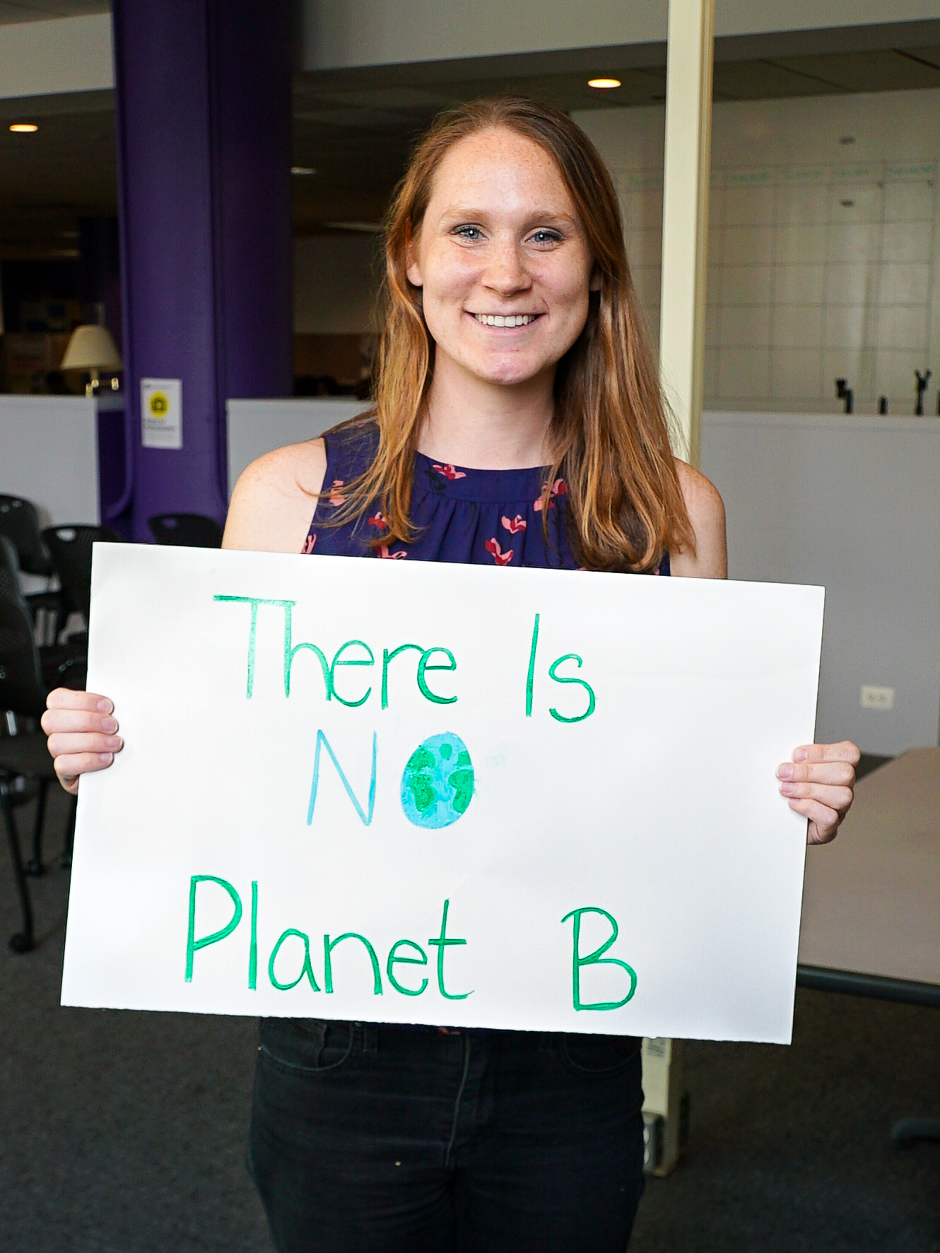 "GPH Student holding ""There is no planet B"" poster"