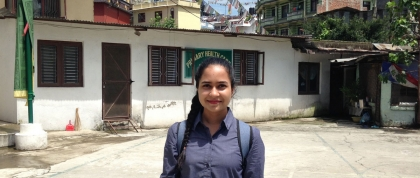 Mehreen in front of a Tibetan settlement office and primary health care clinic.